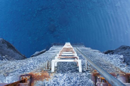 Ladder looking down into ocean