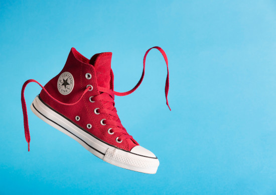 red running shoe with red shoelace