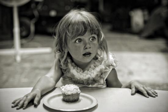 surprised girl wtih a cupcake